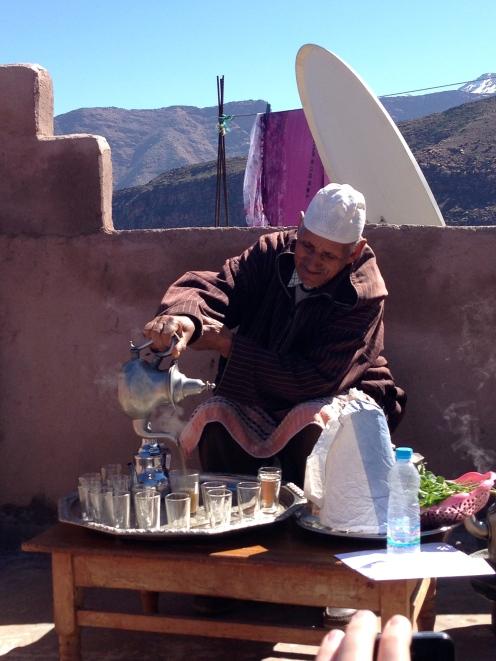 A Berber man pour us some tea